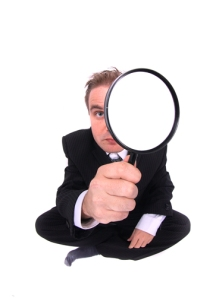 Business man as spy (image by Big Stock Photo)