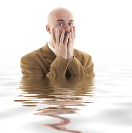 Scared man standing in deep water (Big Stock Photo)