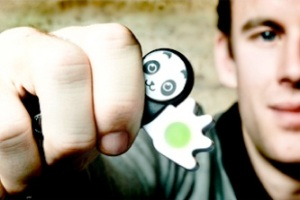Hand holding a Poken device