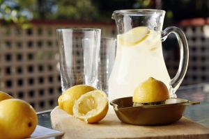 Pitcher of lemonade with lemons